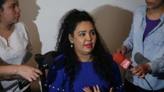 """Veronica Chavez (C) wife of Nicaraguan journalist Miguel Mora director of independent television station """"100% Noticias"""" (100% News), denounces his husband's arrest a day after his TV station was raided and closed by the Nicaraguan Police in Managua on December 22, 2018. - Mora was accused of """"conspiracy"""" and """"terrorism"""" after the closure of his television station, which has been critical of Daniel Ortega's government, amid allegations of an escalation to silence independent press. (Photo by Maynor Valenzuela / AFP)"""