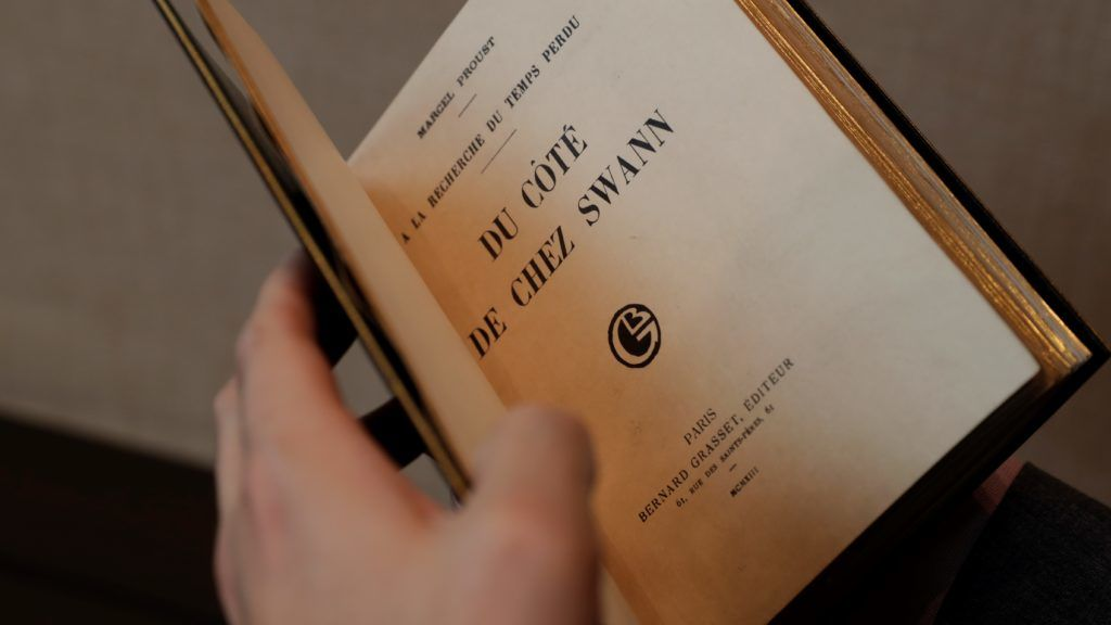 """A Marcel Proust original edition of """"Du cote de chez Swann"""" (Swann's Way) is displayed at Sotheby's auction company in Paris on September 28, 2017, ahead of its scheduled sale on October 30. - This copy, one of five rare first editions to be printed on Japanese paper, has not been seen since 1942 and has an auction estimate of 400,000 - 600,000 Euros - another copy was auctioned by Sotheby's in 2013 and fetched 600,000 Euros. (Photo by Thomas Samson / AFP)"""
