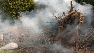 Garden incinerator burning waste material