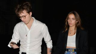 LONDON, UNITED KINGDOM - DECEMBER 11: Brooklyn Beckham with stunning model Hana Cross as they hold hands after British Fashion Awards party on December 11, 2018 in London, England.  PHOTOGRAPH BY Eagle Lee / Barcroft Images December 10, 2018