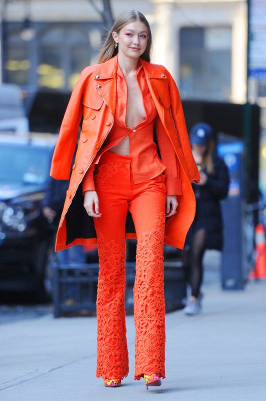 12/11/2018 Gigi Hadid is pictured stepping out in New York City. The 23 year old supermodel went bra free in a orange leather trench coat, matching vest and trousers.  sales@theimagedirect.com Please byline:TheImageDirect.com December 11, 2018