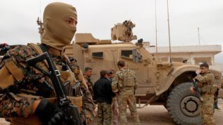 """(FILES) In this file photo taken on November 4, 2018 US forces patrol the Kurdish-held town of Al-Darbasiyah in northeastern Syria bordering Turkey. - The United States is preparing to withdraw its troops from Syria, US media reported December 19, 2018, a major move that throws into question America's role in the region.A US defense official told CNN the US was planning a """"full"""" and """"rapid"""" withdrawal of troops. The Wall Street Journal said the withdrawal would be from northeastern Syria. The Pentagon refused to comment. Currently about 2,000 US forces are in Syria. (Photo by Delil SOULEIMAN / AFP)"""