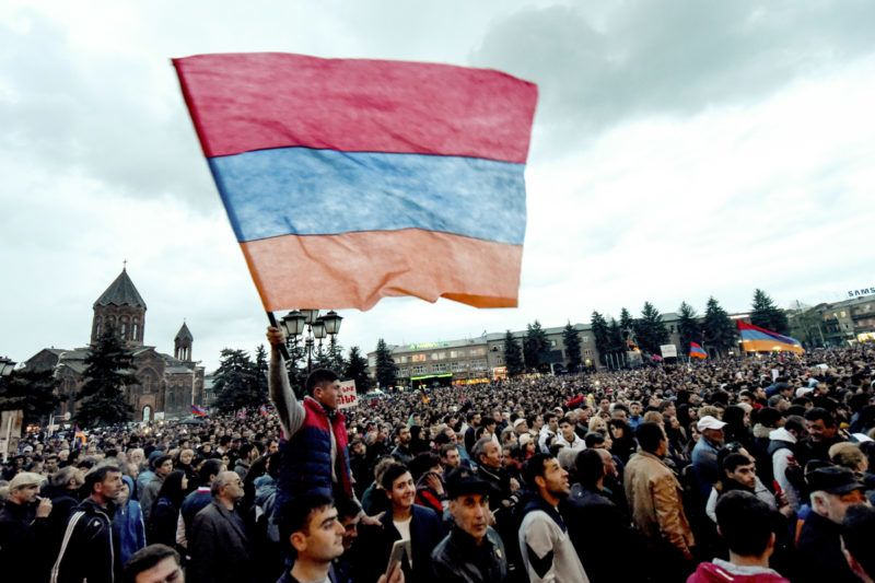 Armenian opposition supporters attend a rally in Gyumri on April 27, 2018. - Armenia's acting head of government on April 27 rebuffed talks proposed by opposition leader, who issued an ultimatum saying he should be elected prime minister in a vote by lawmakers on May 1, in a move expected to further escalate tensions in the Moscow-allied country after two weeks of protests. (Photo by Vano SHLAMOV / AFP)