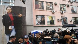 2952552 10/07/2016 Ten giant portraits are posted on the windows of the Novaya Gazeta editorial office during a commemorative event marking the 10th anniversary of journalist Anna Politkovskaya death. Maksim Blinov/Sputnik