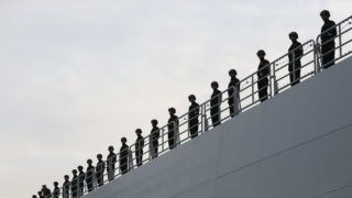 Chinese marines on board the dock landing ship 'Chang Beishan' of the Chinese Navy after landing at the Uebersee Bridge in Hamburg,Germany, 19 January 2015. The Chinese Navy landed for the first time in Hamburg harbor. Photo:CHRISTIANCHARISIUS/dpa
