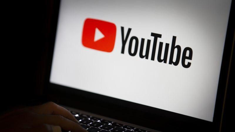 ANKARA, TURKEY - JULY 18 : YouTube logo displayed on screen of a laptop as a person types on keyboard in Ankara, Turkey on July 18, 2018. Aytac Unal / Anadolu Agency