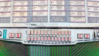 Den Bosch, The Netherlands - May 14, 2017: Close up of a vintage jukebox on an antique fifties to seventies flee market in Den Bosch, The Netherlands