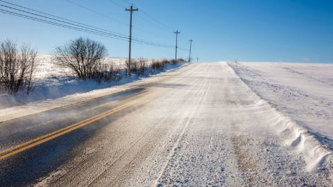 Rural highway with high winds during winter