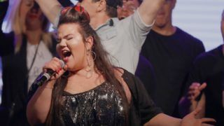 """Israel's Netta Barzilai performs on stage a festive welcome concert in the Israeli coastal city of Tel Aviv on May 14, 2018 after winning the Eurovision Song Contest on Sunday in Lisbon, Portugal. - Netta Barzilai beat 25 other contestants with her up-tempo song """"Toy"""", whose lyrics were inspired by the #MeToo movement. The 25-year-old, who wore a multicoloured kimono, accompanied her winning performance with trills, clucking sounds and chicken-like dance moves in an eye-catching and bizarre performance that is often typical of the Eurovision contest. (Photo by JACK GUEZ / AFP)"""