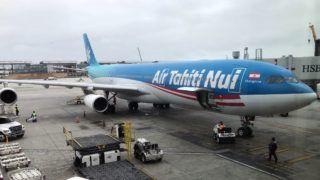 An Air Tahiti Nui Airbus 340 airplane sits at a gate at Los Angeles International Airport on May 24, 2018. (Photo by Daniel SLIM / AFP)