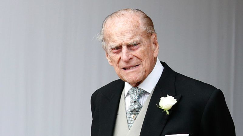 Britain's Prince Philip, Duke of Edinburgh waits for the carriage carrying Princess Eugenie of York and her husband Jack Brooksbank to pass at the start of the procession after their wedding ceremony at St George's Chapel, Windsor Castle, in Windsor, on October 12, 2018. (Photo by Alastair Grant / POOL / AFP)