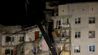 A picture taken on January 2, 2019 shows ruins of a gas explosion that rocked a residential building two days ago in Russia's Urals city of Magnitogorsk. - Rescuers hunted for survivors Wednesday in the rubble of a Russian apartment building hit by a New Year's Eve gas explosion, but found only bodies as the number of confirmed dead rose to 18. Nearly two dozen people were still missing following the explosion, which destroyed 35 apartments in the high-rise in the city of Magnitogorsk in the Ural mountains. (Photo by STR / AFP)