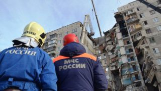 """This handout photograph released by The Russian Emergency Situations Ministry on January 2, 2019, shows officers taking part in a rescue operation two days after a gas explosion rocked a residential building in Russia's Urals city of Magnitogorsk. - Rescuers hunted for survivors in the rubble of a Russian apartment building hit by a New Year's Eve gas explosion, but found only bodies as the number of confirmed dead rose to 18. Nearly two dozen people were still missing following the explosion, which destroyed 35 apartments in the high-rise in the city of Magnitogorsk in the Ural mountains. (Photo by HO / RUSSIAN EMERGENCY SITUATIONS MINISTRY / AFP) / RESTRICTED TO EDITORIAL USE - MANDATORY CREDIT """"AFP PHOTO / RUSSIAN EMERGENCY SITUATIONS MINISTRY"""" - NO MARKETING NO ADVERTISING CAMPAIGNS - DISTRIBUTED AS A SERVICE TO CLIENTS ---"""