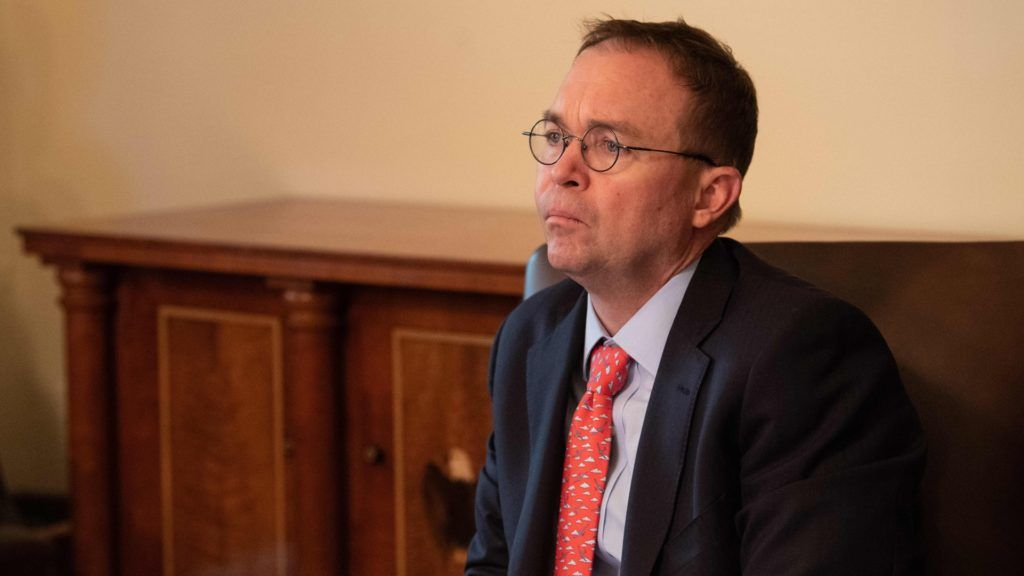 """Acting White House Chief of Staff Mick Mulvaney attends a Cabinet meeting at the White House in Washington, DC, on January 2, 2019. - President Donald Trump warned the US federal government may not fully reopen any time soon, as he stood firm on his demand for billions of dollars in funding for a border wall with Mexico. Addressing a cabinet meeting on the 12th day of the partial shutdown,  Trump warned it """"could be a long time"""" before the impasse is resolved. (Photo by NICHOLAS KAMM / AFP)"""