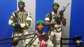 """In this video grab made on a video footage obtained on YouTube on January 7, 2019, Gabon soldiers on state radio called on the people to """"rise up"""" and announced a """"national restoration council"""" would be formed, as an ailing President Ali Bongo is out of the country. - The message was read on state radio by a person who identified himself as the deputy commander of the Republican Guard and head of a group called the Patriotic Youth Movement of the Gabonese Defence and Security Forces. (Photo by - / YOUTUBE / AFP) / RESTRICTED TO EDITORIAL USE - MANDATORY CREDIT """"AFP PHOTO / YOUTUBE """" - NO MARKETING NO ADVERTISING CAMPAIGNS - DISTRIBUTED AS A SERVICE TO CLIENTS"""