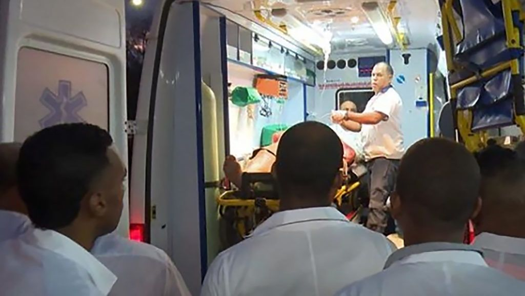 """Handout picture released by Cuban official website www.cubadebate.cu showing an ambulance arriving with a wounded person at the provincial hospital of Guantanamo, eastern Cuba, on January 10, 2019 after a bus overturned while driving on the road linking the city of Baracoa, near the island's eastern tip, to the capital Havana. - Seven people, including four foreign tourists, were killed and 33 injured in an accident involving a coach in eastern Cuba, local press reported on Friday. (Photo by HO / www.cubadebate.cu / AFP) / RESTRICTED TO EDITORIAL USE - MANDATORY CREDIT """"AFP PHOTO / WWW.CUBADEBATE.CU / HO"""" - NO MARKETING NO ADVERTISING CAMPAIGNS - DISTRIBUTED AS A SERVICE TO CLIENTS"""