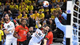 Hungary's Mate Lekai (3L) lines up a shot during the IHF Men's World Championship 2019 Group D handball match between Hungary and Angola at the Royal Arena in Copenhagen on January 13, 2019. (Photo by Jonathan NACKSTRAND / AFP)