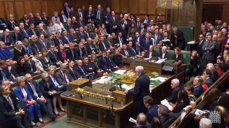 """A video grab from footage broadcast by the UK Parliament's Parliamentary Recording Unit (PRU) shows Britain's main opposition Labour Party leader Jeremy Corbyn (R) standing to give his response and to table a motion of no confidence in the Government in the House of Commons in London on January 15, 2019, after MPs rejected the government's Brexit deal. - British lawmakers voted overwhelmingly Tuesday to reject the EU divorce deal struck between London and Brussels, in a historic vote that leave Brexit hanging in the balance. (Photo by HO / PRU / AFP) / RESTRICTED TO EDITORIAL USE - MANDATORY CREDIT """" AFP PHOTO / PRU """" - NO USE FOR ENTERTAINMENT, SATIRICAL, MARKETING OR ADVERTISING CAMPAIGNS"""