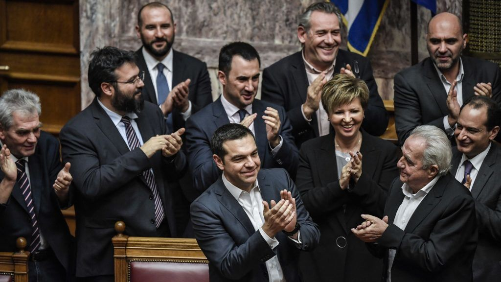 Greek Prime Minister Alexis Tsipras and members of his government applaud after winning a confidence vote at the parliament in Athens on January 16, 2019. - Tsipras survived a confidence vote after a row over a landmark name deal with Macedonia sunk his four-year coalition. A total of 151 lawmakers supported Tsipras' government, including several independent MPs, the official count showed. (Photo by LOUISA GOULIAMAKI / AFP)
