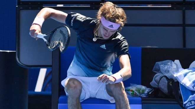 Germany's Alexander Zverev smashes his racquet after a game against Canada's Milos Raonic during their men's singles match on day eight of the Australian Open tennis tournament in Melbourne on January 21, 2019. (Photo by Paul Crock / AFP) / -- IMAGE RESTRICTED TO EDITORIAL USE - STRICTLY NO COMMERCIAL USE --
