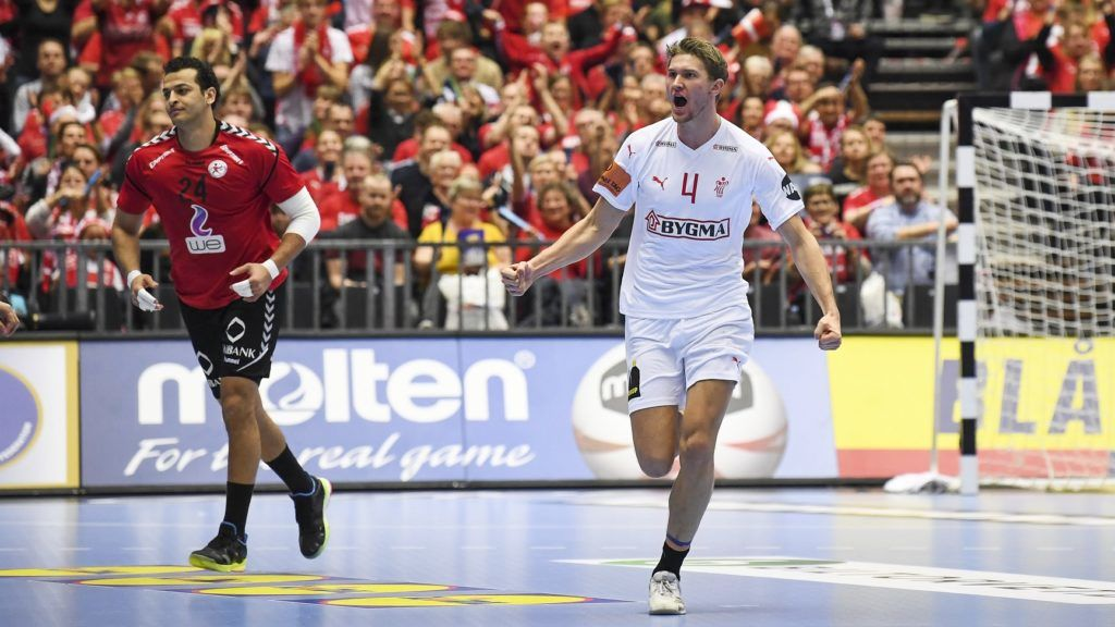 Denmark's Magnus Landin Jacobsen (R) celebrates after scoring during the IHF Men's World Championship 2019 Group II handball match between Egypt and Denmark at the Jyske Bank Boxen arena in Herning on January 21, 2019. (Photo by Jonathan NACKSTRAND / AFP)