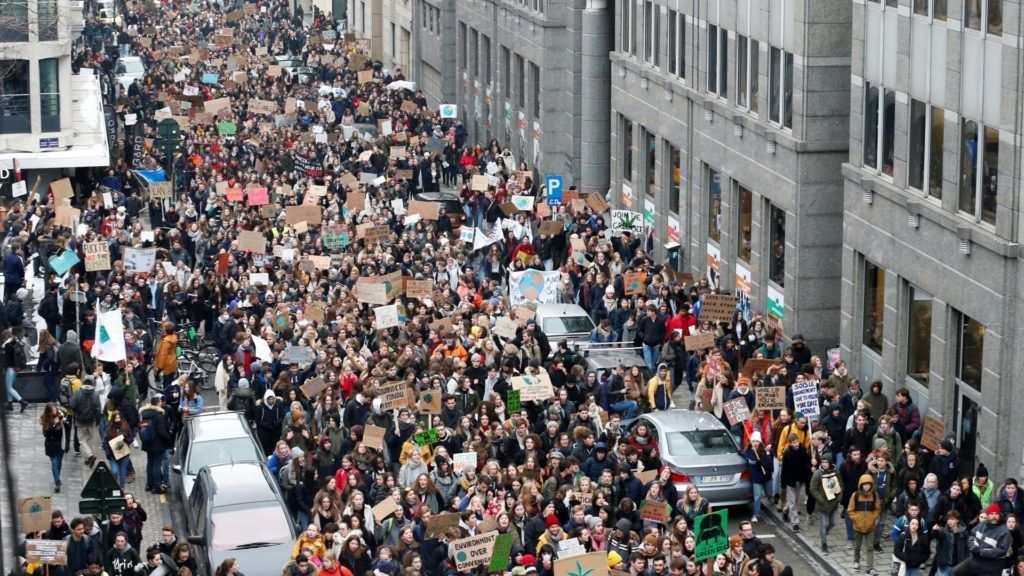 """Youths hold placards and shout slogans during a """"Youth For Climate"""" rally in Brussels, on January 24, 2019, calling on authorities to take action on climate and ecological issues. (Photo by NICOLAS MAETERLINCK / BELGA / AFP) / Belgium OUT"""