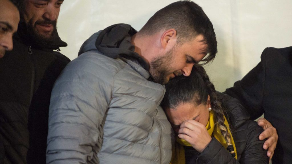 Parents of two-year-old Julen Rosello hug in Totalan, southern Spain, on January 24, 2019. - Miners were lowered on a cage to rescue two-year-old Julen Rosello who fell down a narrow shaft on January 13 as he was playing while his parents prepared a picnic in Totalan. (Photo by JORGE GUERRERO / AFP)