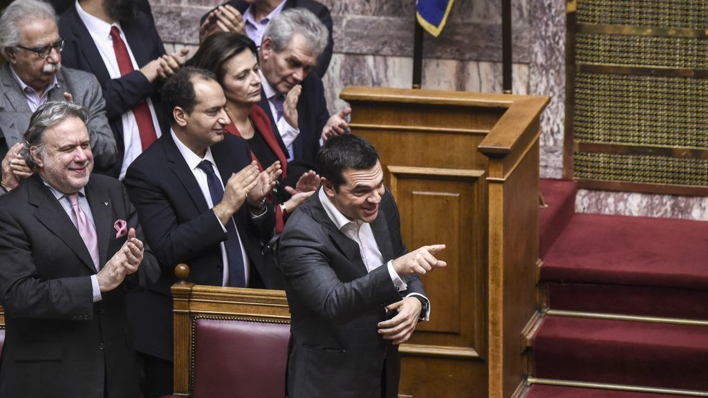 Greece's Prime Minister Alexis Tsipras celebrates after a voting session on the Prespa Agreement, an agreement aimed at ending a 27-year bilateral row by changing the name of Macedonia to the Republic of North Macedonia, at the Greek Parliament, in Athens, on January 25, 2019. - Greek lawmakers  ratified a landmark name change deal with neighbouring Macedonia, handing Prime Minister Alexis Tsipras a diplomatic triumph and bucking street protests to end one of the world's most stubborn diplomatic disputes. (Photo by ANGELOS TZORTZINIS / AFP)