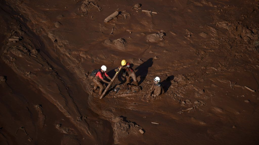 Firefighters search for bodies in the region of Corrego do Feijao in Brumadinho, two days after the collapse of a dam at an iron-ore mine belonging to Brazil's giant mining company Vale near the town of Brumadinho, state of Minas Gerias, southeastern Brazil, on January 27, 2019. - Communities were devastated by a dam collapse that killed at least 37 people at a Brazilian mining complex -- with hopes fading for 250 still missing. A barrier at the site burst on Friday, spewing millions of tons of treacherous sludge and engulfing buildings, vehicles and roads. (Photo by Douglas Magno / AFP)