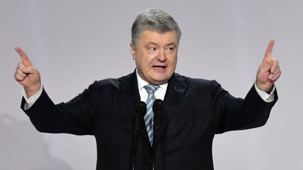 Ukrainian President Petro Poroshenko gives a speech during a meeting with his supporters in Kiev on January 29, 2019. - Ukrainian President Petro Poroshenko on January 29, 2019 launched an uphill battle for re-election, five years on from a bloody uprising that brought him to power on a promise to tackle corruption. (Photo by Genya SAVILOV / AFP)