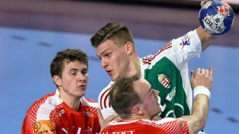 Denmark's Henrik Toft Hansen (R) and Magnus Landin (L) vie with Hungary's Donat Bartok (C) during their match in the 13th edition of the EHF European Men's Handball Championship,  Group D match, Hungary versus Denmark at the Varazdin Arena in Varazdin on January 13, 2018. (Photo by Attila KISBENEDEK / AFP)