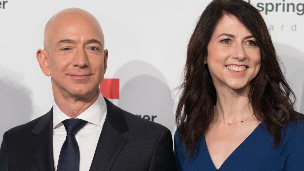 24 April 2018, Germany, Berlin:Head of Amazon Jeff Bezos and his wife MacKenzie Bezos arrive for the Axel Springer award ceremony. Bezos will be receiving the award later. Photo: Jörg Carstensen/dpa