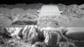 10 January 2019, Bavaria, Kaufbeuren: A snow-covered car stands on the parking lot of a supermarket. Photo: Karl-Josef Hildenbrand/dpa
