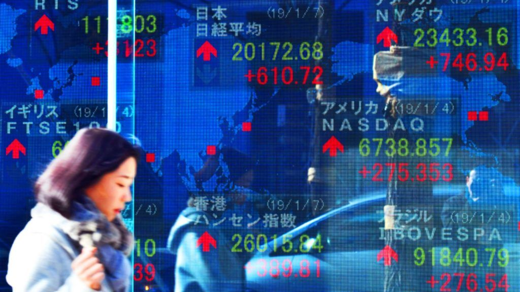 An electric board shows the Nikkei Stock Average price, Dow Jones Industrial Average and other countries' Share prices soaring in Chuo Ward, Osaka on January 7, 2019. ( The Yomiuri Shimbun )