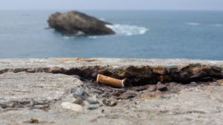 Cigarette end on a low wall Biarritz France.  Biosphoto / Frédéric Decante