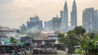 Kuala Lumpur, Malaysia, in January 2019. As one of the fastest growing metropolitan regions in Southeast Asia, Kuala Lumpur has undergone rapid development in recent decades. The city is in permanent construction - modern skyscrapers are being built, road junctions are multiplying. On the flip side, contemporary high-rise towers are still surrounded by mud streets and ramshackle slums; luxury restaurants and giant shopping malls are adjacent to street food stalls and old-style bazaars.  (Photo by Oleksandr Rupeta/NurPhoto)