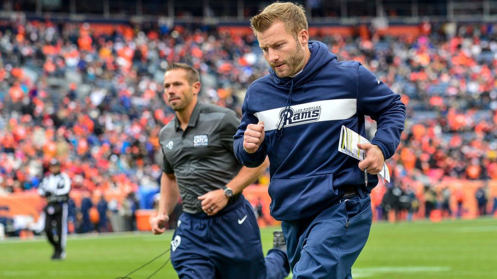 DENVER, CO - OCTOBER 14:  Head coach Sean McVay of the Los Angeles Rams runs off the field for halftime during a game against the Denver Broncos at Broncos Stadium at Mile High on October 14, 2018 in Denver, Colorado. (Photo by Dustin Bradford/Getty Images)
