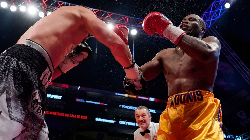 QUEBEC CITY, QC - DECEMBER 1:   Oleksandr Gvosdyk (black trunk) punches Adonis Stevenson (gold trunk) during their WBC light heavyweight championship fight at the Videotron Center on December 1, 2018 in Quebec City, Quebec, Canada. (Photo by Mathieu Belanger/Getty Images)