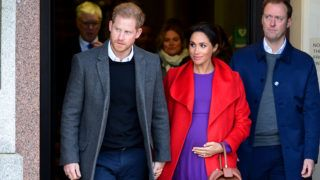BIRKENHEAD, ENGLAND - JANUARY 14:  Prince Harry, Duke of Sussex and Meghan, Duchess of Sussex depart from Birkenhead Town Hall on January 14, 2019 in Birkenhead, England. (Photo by Richard Martin-Roberts/Getty Images)