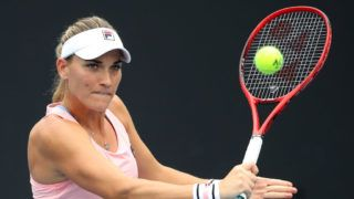 MELBOURNE, AUSTRALIA - JANUARY 17:  Timea Babos of Hungary plays a backhand in her doubles first round match with Kristina Mladenovic of France against Raluca Olaru of Romania and Galina Voskoboeva of Kazakhstan during day four of the 2019 Australian Open at Melbourne Park on January 17, 2019 in Melbourne, Australia.  (Photo by Mark Kolbe/Getty Images)