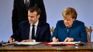AACHEN, GERMANY - JANUARY 22: German Chancellor Angela Merkel and French President Emmanuel Macron sign the Aachen Treaty on January 22, 2019 in Aachen, Germany. The treaty is meant to deepen cooperation between the countries as a means to also strengthen the European Union. It comes 56 years to the day after then German Chancellor Konrad Adenauer und French President Charles de Gaulle signed the Elysee Treaty, or Joint Declaration of Franco-German Friendship. (Photo by Sascha Schuermann/Getty Images)