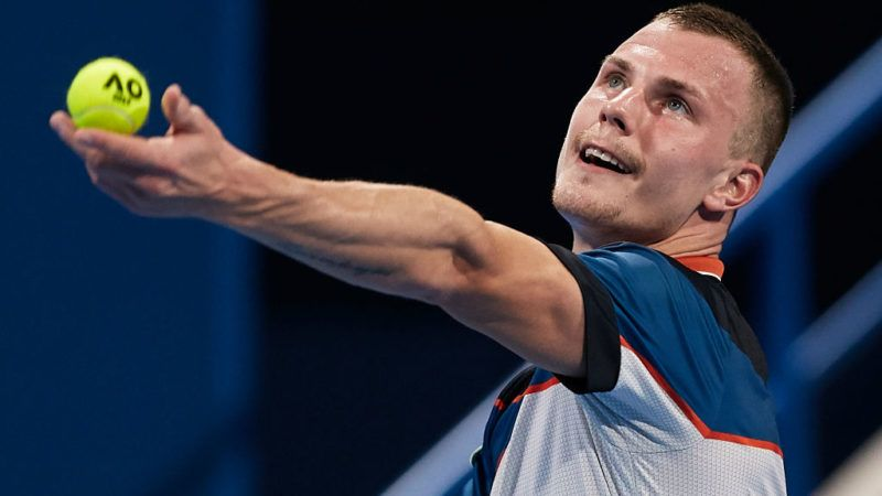 DOHA, QATAR - JANUARY 02: Marton Fucsovics of Hungary serves during his match against Novak Djokovic of Serbia during day three of the ATP Qatar ExxonMobil Open at Khalifa International Tennis and Squash Complex on January 02, 2019 in Doha, Qatar. (Photo by Quality Sport Images/Getty Images)