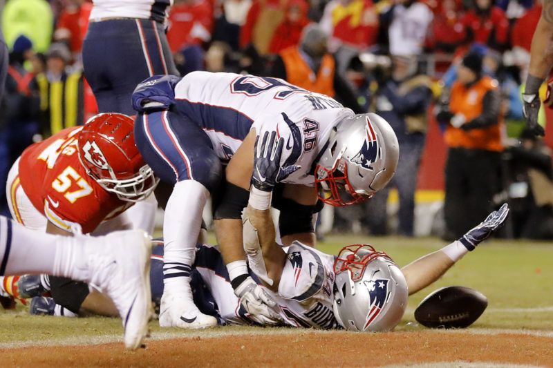 KANSAS CITY, MISSOURI - JANUARY 20:  Rex Burkhead #34 of the New England Patriots celebrates with James Develin #46 after scoring the game-winning touchdown to defeat the Kansas City Chiefs in overtime during the AFC Championship Game at Arrowhead Stadium on January 20, 2019 in Kansas City, Missouri. The Patriots defeated the Chiefs 37-31. (Photo by David Eulitt/Getty Images)