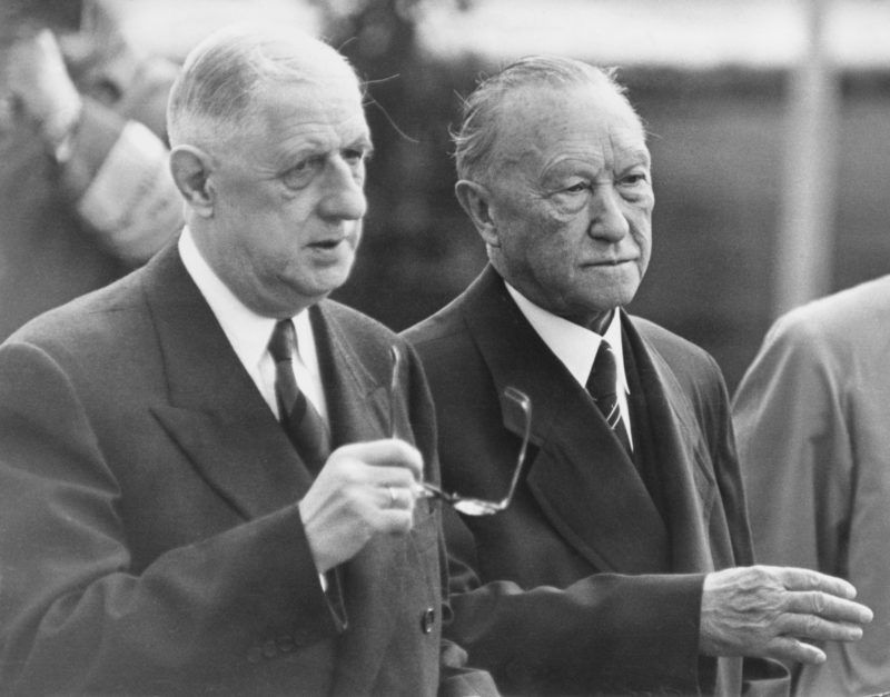 French President Charles De Gaulle (1890 - 1970, left) is met by West-German Chancellor, Konrad Adenauer (1876 - 1967) at the airport in Bonn, West-Germany, at the start of an official visit, September 1962. (Photo by Authenticated News/Archive Photos/Getty Images)