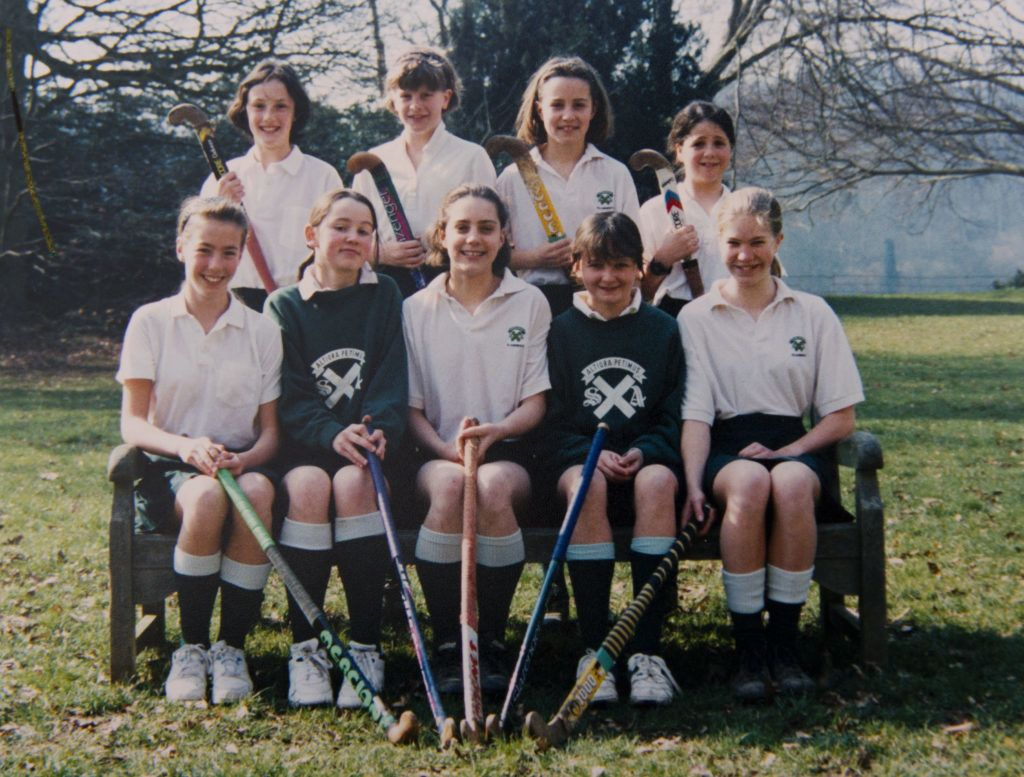 PANGBOURNE, UNITED KINGDOM - UNDATED:  In this undated collect photo provided by St Andrew's School, Kate Middleton (front row, C) is pictured in a hockey team photo during her time as a pupil at St Andrew's School in Pangbourne, Berkshire, England (1986-1995). Catherine, Duchess of Cambridge re-visited her former school on November 30, 2012 to take part in a day of activities and festivities to mark the occasion of St Andrew's Day. The Duchess visited the Pre-Prep School for under-5s, unveiled a plaque to officially open a new artificial turf playing field and met members of the school's hockey team, which she played for during her time as a pupil at the school. She was also given a private tour of the school and watched the school's Progressive Games which are traditional games played indoors by teachers and students on St Andrew's Day.  (Photo provided by St Andrew's School - WPA Pool/Getty Images)