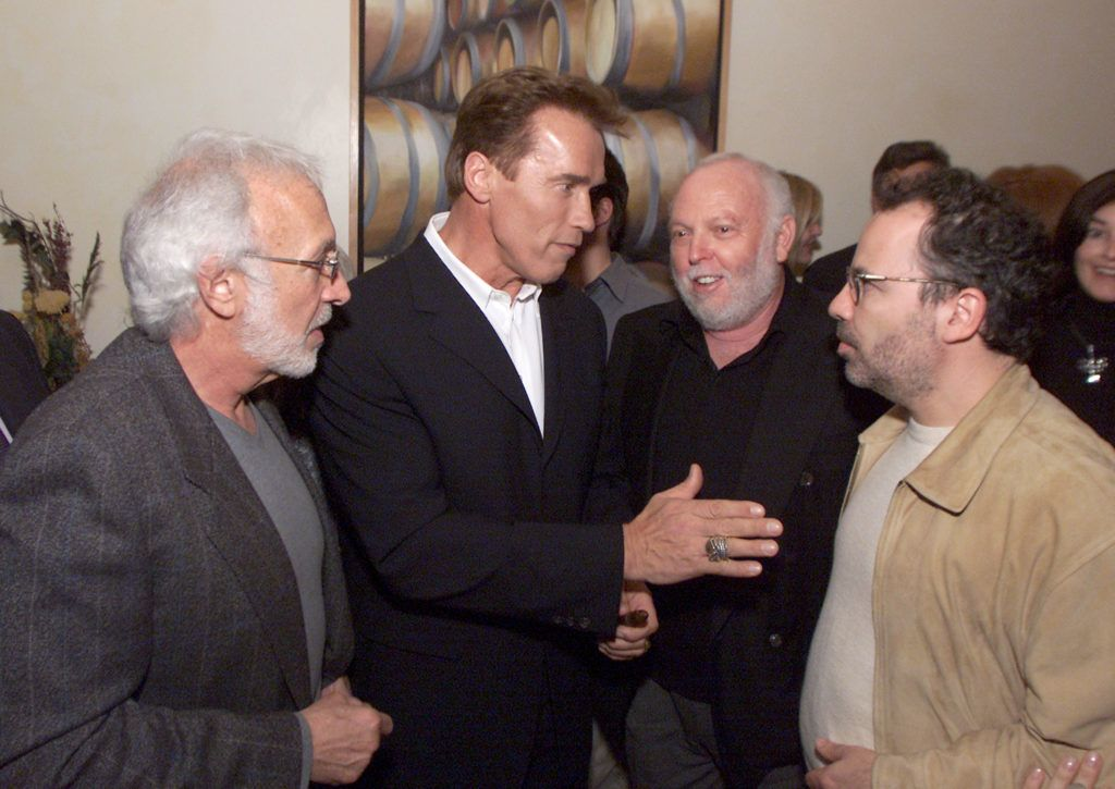 """T3s Stan Winston, Arnold Schwarzenegger, """"T3"""" producer Andy Vajna and """"T3"""" director Jonathan Mostow at Napa after the premiere of """"Collateral Damage"""" at the Village Theater in Los Angeles, Ca. Monday, Feb. 4, 2002. Photo by Kevin Winter/Getty Images."""