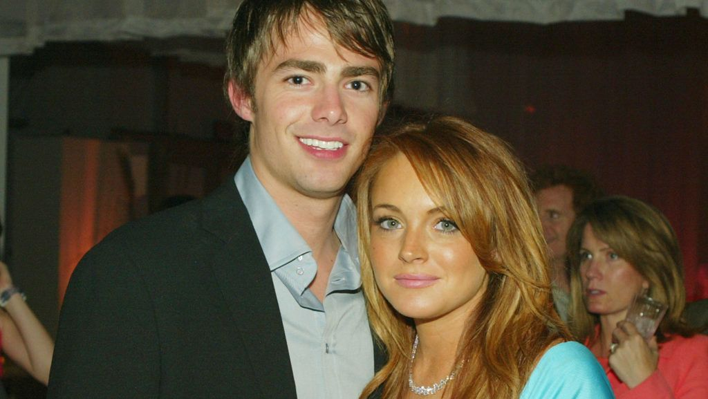 """LOS ANGELES - APRIL 19:  Cast members Jonathan Bennett and Lindsay Lohan pose at the after-party for Paramount's """"Mean Girls"""" at the Cinerama Dome Theater on April 19, 2004 in Los Angeles, California.  (Photo by Kevin Winter/Getty Images)"""