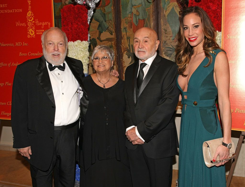 BEVERLY HILLS, CA - FEBRUARY 27:  Film producer and Hungarian government film industry commissioner Andrew G Vajna, Hungarians in Hollywood hosts Bonnie and Bela Bunyik and director of Miss Universe Timea Vajna pose for a photo on the red carpet at the Pre-Oscar Hungarians in Hollywood Gala celebrating the Academy Award nominated film Son of Saul at the Peninsula Hotel on February 27, 2016 in Beverly Hills, California.  (Photo by Sean tSabhasaigh/Getty Images)