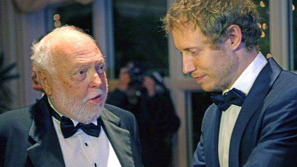 BEVERLY HILLS, CA - FEBRUARY 27:   Film producer and Hungarian government film industry commissioner Andrew G Vajna speaks with Son Of Saul director Laszlo Nemes on the red carpet at the Pre-Oscar Hungarians in Hollywood Gala celebrating the Academy Award nominated film Son of Saul at the Peninsula Hotel on February 27, 2016 in Beverly Hills, California.  (Photo by Sean tSabhasaigh/Getty Images)
