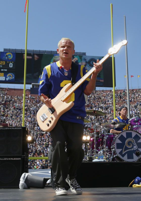 LOS ANGELES, CA - SEPTEMBER 18:  Flea of the Red Hot Chili Peppers performs before the Los Angeles Rams home opening NFL game against the Seattle Seahawks at Los Angeles Coliseum on September 18, 2016 in Los Angeles, California.  (Photo by Jeff Gross/Getty Images)